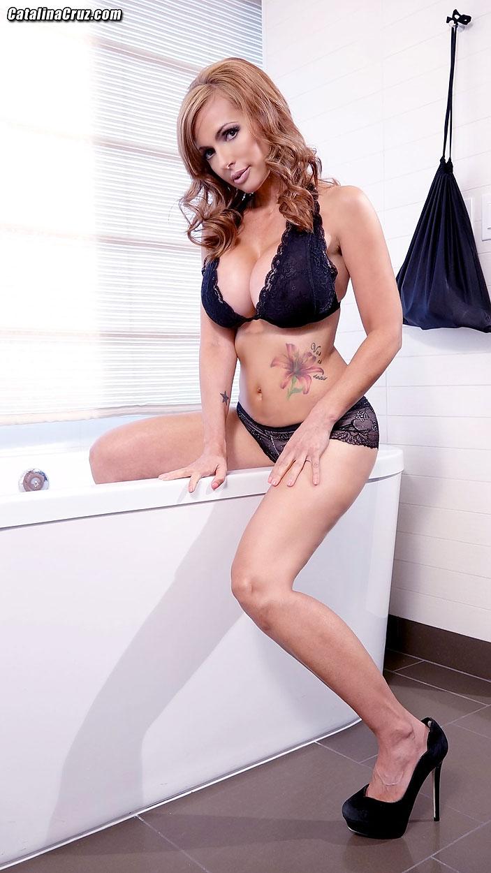 Busty brunette lotion her big tits on webcam